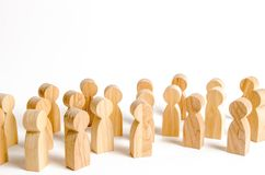 A crowd of wooden figures of people on a white background. Social survey and public opinion, the electorate. Population royalty free stock photography