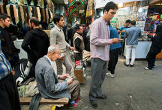 Crowd young and elderly people earn and spend money in the bazaar Stock Image