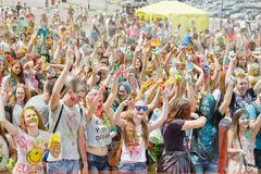 A crowd of young men with painted faces on the colorfest. VOLGOGRAD - JUNE 12: Crowd of young people dancing to the music at the festival of colors at the Royalty Free Stock Photography