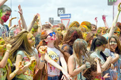 A crowd of young men with painted faces on the colorfest. VOLGOGRAD - JUNE 12: Crowd of young people dancing to the music at the festival of colors at the Stock Photography