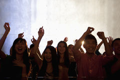 A crowd of young people dancing in a nightclub Stock Photography