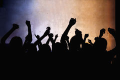 A crowd of young people dancing in a nightclub royalty free stock photos