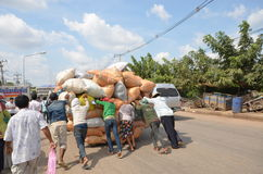 Crowd of young people pushing a cart overloaded bags. Across the border thailand cambodia Royalty Free Stock Photos