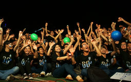 Crowd of young person raise hand in earth hour. HO CHI MINH CITY, VIET NAM- MAR 29: Crowd of young person raise hand with happiness, smile, joyfull, they support Royalty Free Stock Photos