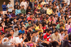 Crowd of young students watching. Delhi, India; 14th Mar 2015 - Crowd of young students, men and women watching a show in Delhi college of Engineering Stock Image