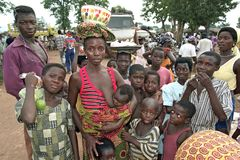 Crowded on the Abease market in Ghana. Ghana, Brong-Ahafo region, town Abease: group portrait of people on the market place of Abease, they want to sell or buy Royalty Free Stock Image