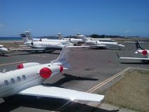 Crowded aircraft parking erea Stock Images