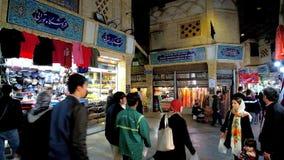 Crowded alley in Tajrish Bazaar, Tehran, Iran. TEHRAN, IRAN - OCTOBER 25, 2017: The crowded alleyway of Tajrish Bazaar with beautiful Persian styled tiled signs stock video