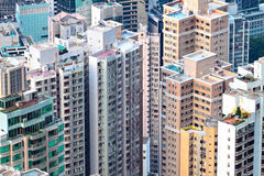 Crowded apartment building Stock Photos