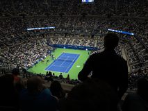 Ashe Stadium - US Open Tennis. A crowded Arthur Ashe Stadium, under a closed roof, for a 2017 U.S. Open tennis match, Nadal vs. Rublev Royalty Free Stock Image