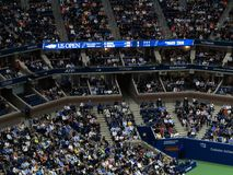 Ashe Stadium - US Open Tennis. A crowded Arthur Ashe Stadium, under a closed roof, for a 2017 U.S. Open tennis match, Nadal vs. Rublev Royalty Free Stock Photos