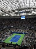 Ashe Stadium - US Open Tennis. A crowded Arthur Ashe Stadium, under a newly installed closed roof, for a 2017 U.S. Open tennis match, Vandeweghe vs. Pliskova Royalty Free Stock Photography