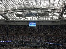 Ashe Stadium - US Open Tennis. A crowded Arthur Ashe Stadium, under a newly installed roof, for a 2017 U.S. Open tennis match, Nadal vs. Rublev Royalty Free Stock Images