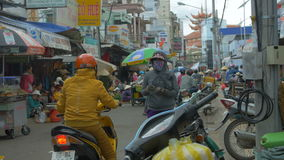 Crowded Asian market in the smog and bustle. With a bunch of signboards stock video footage