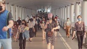 Less crowded Asian people wear face mask walk in pedestrian walkway. Coronavirus disease Covid-19 pandemic outbreak concept