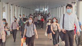 Less crowded Asian people wear face mask, walk in pedestrian walkway. Coronavirus disease Covid-19 pandemic outbreak effect