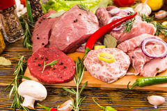 Crowded assortment of various meats and veggies Stock Photography