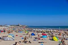Crowded Atlantic Ocean beach in Lisbon, Portugal Royalty Free Stock Photos
