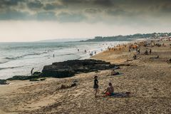 Crowded Atlantic summer beach in Carcavelos, Portugal. Carcavelos, Portugal - September 5th, 2018: Crowded Atlantic summer beach in Carcavelos, Portugal royalty free stock images