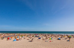 Crowded Atlantic summer beach in Portugal Royalty Free Stock Photo