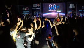 Crowded atmosphere, raise hand in earth hour. HO CHI MINH CITY, VIET NAM- MAR 29: Impression activity at night of young people at earth hour, youth raise hand in Royalty Free Stock Image