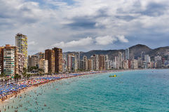 Crowded beach of Benidorm on a cloudy day Royalty Free Stock Photo