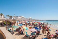 Crowded beach in Cadiz. CADIZ, SPAIN - AUGUST 27, 2014: People sunbathing on Caleta Beach, small and very popular beach located in Cadiz city center Stock Photos