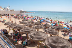 Crowded beach in Cadiz Stock Images