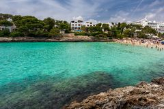 Crowded beach Cala Gran in Cala d`Or, Mallorca. During summer season Royalty Free Stock Photography