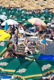 Crowded beach. Canj, Montenegro - July 10, 2016: Crowded beach full of parasols, on a hot summer day Stock Image