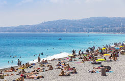 Crowded beach in City of Nice, France Royalty Free Stock Photo