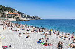 Crowded beach in City of Nice, France Stock Photo