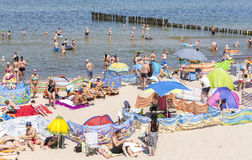 Crowded beach in Dziwnowek, one of the most visited summer spots Stock Image