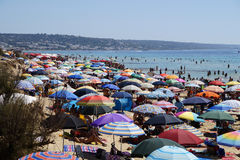 Crowded Beach. GALLIPOLI, ITALY - 27 AUGUST 2014 :nVery Crowded Beach Full Of People At Mediterranean Sea.nGallipoli is a major tourist town in the southern royalty free stock images