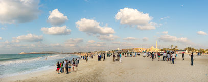 Crowded beach of Jumeirah Marina on sunny day, Dubai. Royalty Free Stock Photos