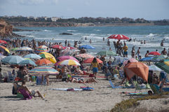 Crowded beach. LA ZENIA, ORIHUELA, COSTA BLANCA, SPAIN ON JULY 29 2012: Beach crowded with sun-loving holidaymakers on July 29, 2012 in La Zenia, Spain Royalty Free Stock Photo