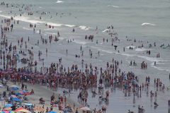 Crowded beach - Myrtle beach SC. Sand ocean and Sea royalty free stock photos