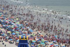 Crowded beach - Myrtle beach SC. Sand ocean and Sea royalty free stock photo