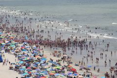 Crowded beach - Myrtle beach SC. Sand ocean and Sea stock photography