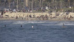 Crowded beach near the coastal city Tel Aviv. View of crowded beach near the coastal city Tel Aviv stock footage