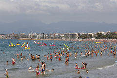 Crowded beach with pedal boats Stock Photos