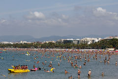 Crowded beach with pedal boats Royalty Free Stock Photo