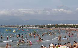 Crowded beach with pedal boats Stock Photo