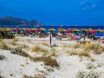 Crowded beach in Sardinia Stock Photo