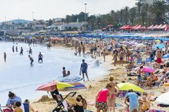 Crowded Beach in Spain Stock Photo