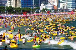 Crowded Beach In Summer. Swimmers enjoying Haeundae Beach. At the height of summer more than a million people are estimated to visit Haeundae during the weekend Stock Images