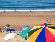 Crowded beach at summer. With sun umbrellas stock images