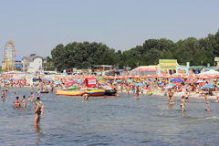 Crowded beach in the summer season Royalty Free Stock Image