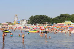 Crowded beach in the summer season Stock Photos