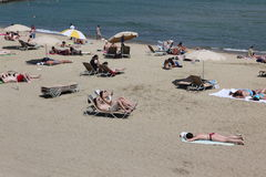 Crowded beach with tourists and locals in s Stock Photo